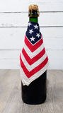 Bottle of beer with an American flag Royalty Free Stock Photography