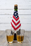 Bottle of beer with an American flag Royalty Free Stock Photos