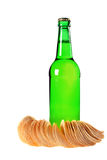 A bottle of beer and chips Stock Photos