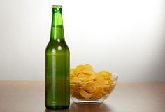 Bottle of beer and chips Royalty Free Stock Photography