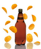 Bottle of beer with chips falling Stock Images