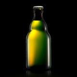 Bottle of beer or cider  on black Royalty Free Stock Photo