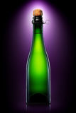 Bottle of beer, cider or champagne isolated on black background Stock Photography