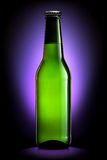 Bottle of beer or cider isolated on dark blue background Stock Photo