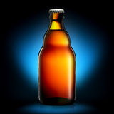Bottle of beer or cider isolated on dark blue background Royalty Free Stock Photo