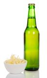 Bottle of beer and dried squids in a bowl Royalty Free Stock Photography