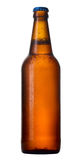 Bottle of beer with drops. Bottle of beer with drops on white background. The file contains a path to cut Royalty Free Stock Images