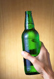 Bottle of beer with drops Royalty Free Stock Photos
