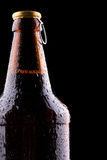 Bottle of beer with drops. On a black Stock Photos