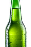 Bottle of beer with drops isolated Royalty Free Stock Images
