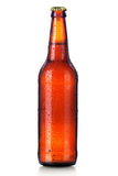 Bottle of beer with drops isolated on white Stock Photos