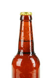 Bottle of beer with drops on white background. Stock Photography