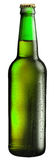 Bottle of beer with drops on white background. The file contains Royalty Free Stock Image