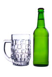 A bottle of beer and an empty beer mug Royalty Free Stock Photo