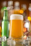 Bottle of beer with glass on bar desk Stock Image