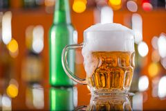 Bottle of beer with glass on bar desk Stock Photo