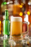 Bottle of beer with glass on bar desk Royalty Free Stock Image