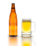 Bottle of beer with glass isolated on white Stock Photos