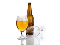 Bottle of beer and glasses isolated on white Stock Photos
