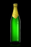 Bottle of beer with golden foil  on black background Royalty Free Stock Photos