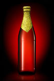 Bottle of beer with golden foil isolated on black background Royalty Free Stock Images