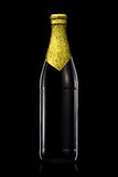 Bottle of beer with golden foil isolated on black background Stock Image