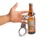 Bottle beer and handcuffs Royalty Free Stock Images