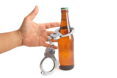 Bottle beer and handcuffs Stock Images
