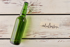 Bottle of beer, heartbeat image. stock images