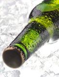 Bottle of beer on ice Stock Photo