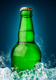Bottle of beer with ice Royalty Free Stock Photography