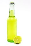 A Bottle of Beer with a Lime. A bottle of lime beer with lime slice on white background Royalty Free Stock Images