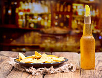 Bottle of beer with lime and  nachos Royalty Free Stock Image