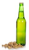 Bottle of beer and pistachios Royalty Free Stock Photography