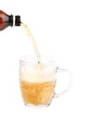 Bottle of beer pouring into a mug. Stock Image