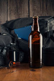Bottle of beer on tourism basket background Royalty Free Stock Photo