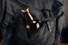 Bottle of beer and travel bag Royalty Free Stock Images