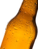 Bottle of beer with water-drop Stock Photos