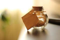 Bottle. With a blank paper Stock Photography