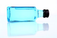 Bottle with blue liquid Royalty Free Stock Photos