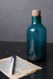 Bottle and the book on the table. Beautiful empty bottle and other items on the table Stock Photo
