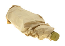 Bottle of booze in paper bag Royalty Free Stock Image