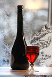 Bottle bottle of red wine on wintry background stock photo