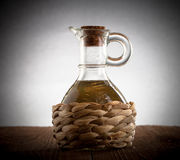 Bottle with braided filled with olive oil. vignetting Royalty Free Stock Photos