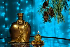 A bottle of brandy and candle in New year with Christmas tree branches Stock Images