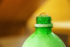 Bottle with bubbles. Frosted green bottle with bubbles Stock Photo