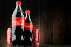 Bottle and can of carbonated soft drink Coca Cola Royalty Free Stock Photo
