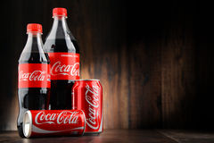 Bottle and can of carbonated soft drink Coca Cola Stock Image