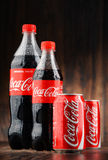 Bottle and can of carbonated soft drink Coca Cola Stock Photography