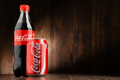 Bottle and can of carbonated soft drink Coca Cola Stock Photo